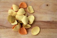 Handful of veggie chips Stock Photo