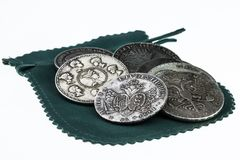 Handful of vintage coins and wallet stock photo
