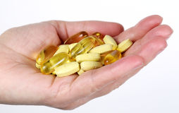 Handful of vitamins Royalty Free Stock Images