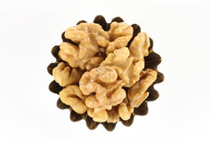 Handful of walnut figured form. On a white background Royalty Free Stock Image