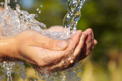 Handful of water Stock Photo