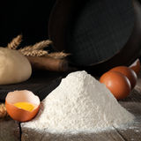 Handful of wheat flour close up with brown eggs stock photos