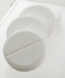 Handful of white pills. On a lid Royalty Free Stock Image