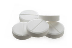 Handful of white pills Royalty Free Stock Image