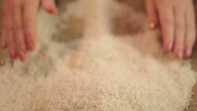 Handful of white rice, cereal grain grown in Asia, high quality food product. Stock footage stock footage