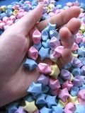 Handful of Wishes. Colourful paper stars stock photo