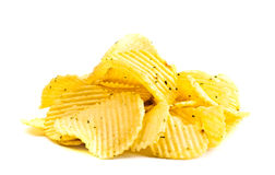 Handful of yellow potato chips Royalty Free Stock Photography