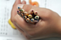 A handfull of crayons. Every student should have all neccessary accessories for school education. Crayons mostly find their usage in art, and sometimes are well Royalty Free Stock Photos