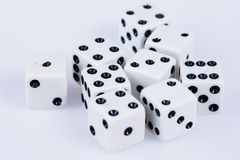 Handfull of dice on white. Nine dice scattered with mixed numbers on a white background Royalty Free Stock Photography