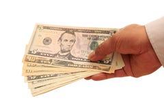 Handfull dos dólares Fotografia de Stock