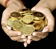Handfull of gold stock image