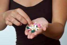 Handfull of pills Royalty Free Stock Image