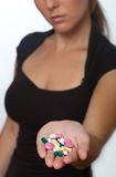 Handfull of pills Royalty Free Stock Photography