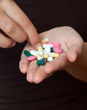 Handfull of pills Stock Image