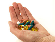 Handfull of pills, isolated Stock Photography
