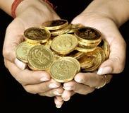 Handfull van goud Stock Afbeelding