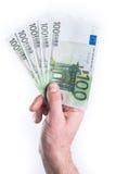 Handgeldgeben Stockfoto