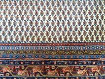 Handgemachter orientalischer Teppich stockfotografie