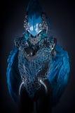 Handgemachtes Anreden eines Vogels oder der mythologischen Zahl mit blauem Flügel Lizenzfreie Stockfotografie