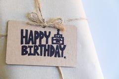 Handgemachtes Geschenk mit glücklicher Glückwunschkarte, Feier congratulati stockfotografie