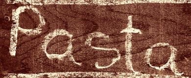 Handgeschriebene Aufschrift TEIGWAREN mit Kreide stockbild