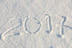 Handgeschriebenes 2017 im Schnee Stockbild