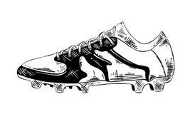 Handgezogene Skizze des Fußballschuhes in Schwarzem lokalisiert auf weißem Hintergrund Ausführliche Weinleseradierungs-Artzeichnu stock abbildung