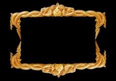 Handgjord gammal dekorativ guld- ram -, inristat - som isoleras på svart bakgrund royaltyfria foton