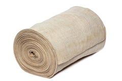 Handgjord textil i rulle som isoleras på vit royaltyfri fotografi
