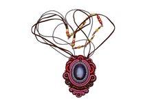 Handgjorda härliga märkes- smycken Arkivbilder