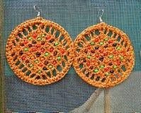 Handgjorda orange örhängen Royaltyfri Bild