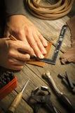 Handgjort läderhjälpmedel - materielbild Arkivbilder