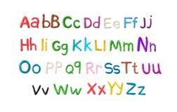 Handgjort plasticinealfabet Engelska färgrika bokstäver av att modellera lera Fotografering för Bildbyråer