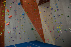 Handgrips on climbing wall at gym. Colorful handgrips on climbing wall at gym Royalty Free Stock Photos