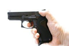 Handgun. Hand with handgun on the white background Stock Photo