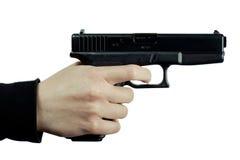 Handgun. Black Gun in hands on white background royalty free stock image