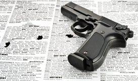 Handgun. Vintage handgun isolated on newspaper (closeup Royalty Free Stock Images