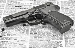 Handgun. Vintage handgun isolated on newspaper (closeup Stock Photography