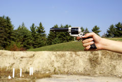 The Handgun. A hand holding and aiming a revolver handgun royalty free stock photography