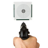 Handgun aimed on a shooting target Royalty Free Stock Photo