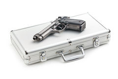 Handgun on aluminium case Royalty Free Stock Photos