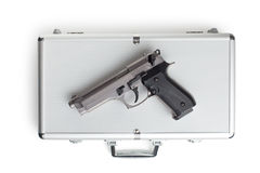 Handgun on aluminium case Stock Photography