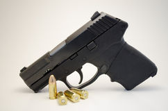 Handgun with ammo. A black hand gun with 9mm ammunition Royalty Free Stock Image