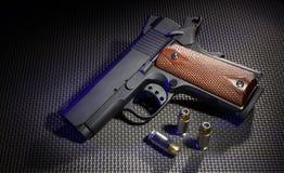 Handgun and ammo Stock Photos