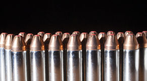 Handgun ammo with red tipped bullets Stock Photos