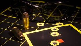Handgun ammo and target Royalty Free Stock Photos
