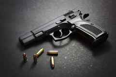 Handgun with ammunition Stock Photography