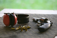 handgun ammunition and earmuffs Royalty Free Stock Images