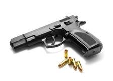 Handgun with ammunition. Over white background Stock Photo