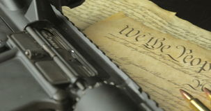 Handgun Assault Rifle and Ammunition on the US Constitution stock footage